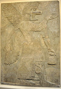 Wall relief depicting an eagle headed and winged man, Apkallu, from Nimrud